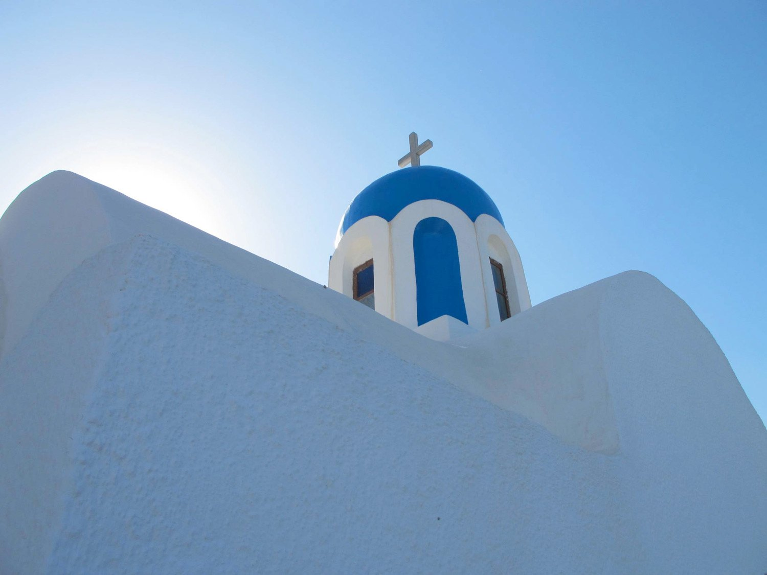 Discover the famous blue domes of Santorini with the Santorini Shore Excursions by Omega Travel.